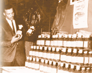 Argia B at tradeshow in 1960s presenting his famous MUMBO SAUCE